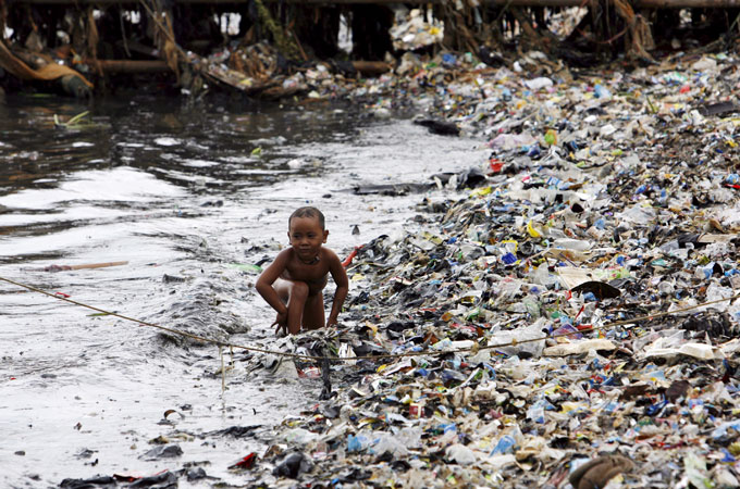 A child surrounded by plastic garbage: http://www.aljazeera.com/indepth/features/2012/06/20126681156629735.html